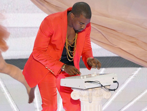 Kanye West performing live on stage with an MPC